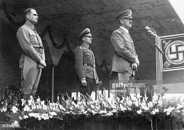 Nuremberg, Germany: Rudolf Hess, high-ranking Nazi, with Hitler and Von Schirach on the podium of the stadium of Nuremberg. Ca. 1930s.