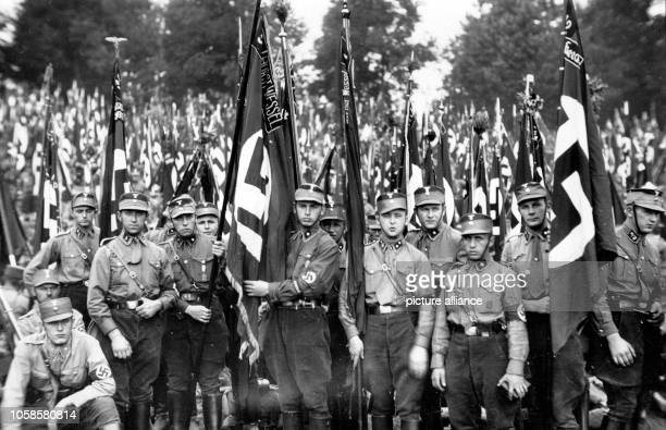 """Nuremberg Rally 1933 in Nuremberg, Germany - Line-up of members of the SA at the Nazi party rally grounds, amongst them the standard """"Horst Wessel""""...."""