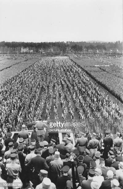 Nuremberg Rally 1933 in Nuremberg, Germany - Members of the SA at the Nazi party rally grounds in front of Adolf Hitler on the speaker's platform....