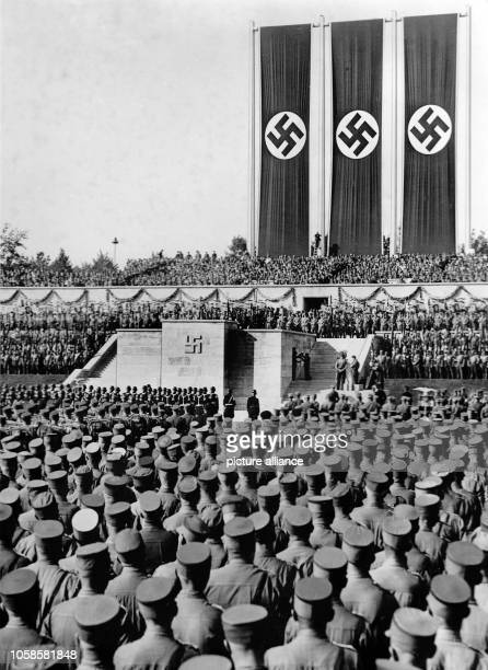 Nuremberg Rally 1936 in Nuremberg Germany Roll call of the Sturmabteilung on Zeppelin Field at the Nazi party rally grounds in front of Adolf Hitler...