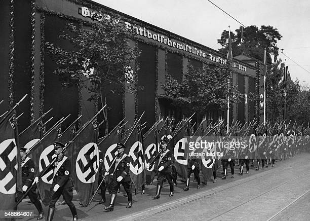 Nuremberg Rally 1937 Flag detachments of the SS marching past the Noris Hall where an 'AntiBolshevik Exhibition' took place 1937 Photographer...
