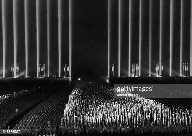 Nuremberg Rally 1937 The 'dome of light' over the rally ground during a mass parade at night 1937 Photographer PresseIllustrationen Heinrich Hoffmann...