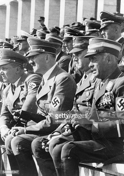 Nuremberg Rally 1938 Nazi leaders watching performances at the rally ground on 'Community Day' from the left Martin Bormann Adolf Hitler SA chief of...