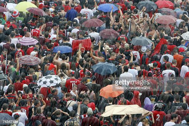 Nuremberg supporters welcome their team to a victory celebration in spite of rain 27 May 2007 in Nuremberg southern Germany Nuremberg won the German...