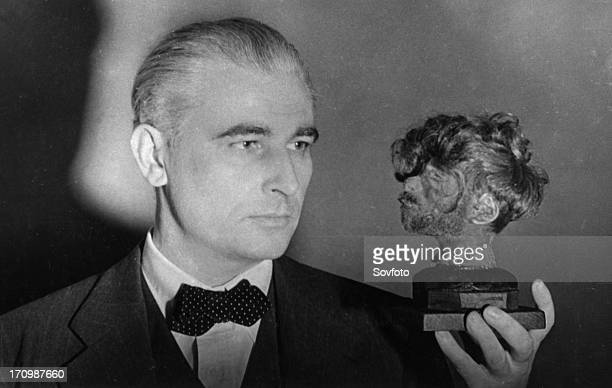 Nuremberg war crimes trial world war 2 american prosecutor thomas j dodd holding a shrunken head that decorated the desk of the chief of the...