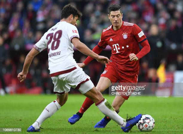 Nuremberg's defender Lukas Muehl and Bayern Munich's Polish striker Robert Lewandowski vie for the ball during the German first division Bundesliga...