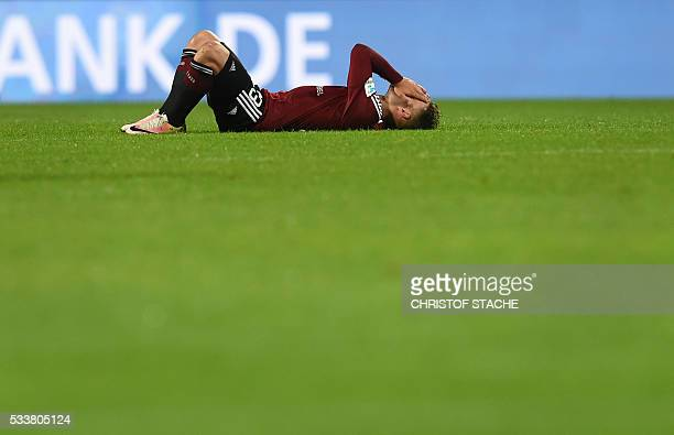 Nuremberg's defender Tim Leibold reacts after the German Bundesliga secondleg relegation football match FC Nuremberg vs Eintracht Frankfurt in...
