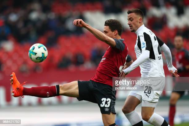 Nuremberg's Georg Margreitter and Sandhausen's Philipp Foerster vie for the ball during the 2nd Bundesliga soccer match between 1 FC Nuremberg and SV...