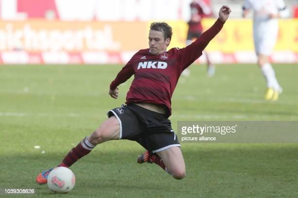 Nuremberg's Markus Feulner controls the ball during the Bundesliga soccer match between 1 FC Nuremberg and FSV Mainz 05 at Grundig Stadium in...