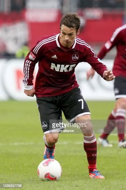 Nuremberg's Markus Feulner kicks the ball during the German Bundesliga soccer match between 1 FC Nuremberg and Borussia Moenchengladbach at Stadium...