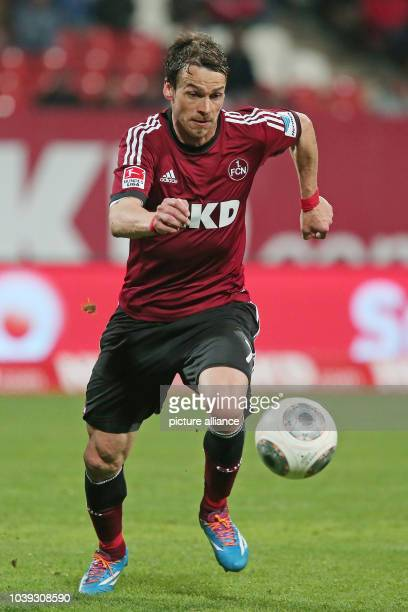 Nuremberg's Markus Feulner vies for the ball during the Bundesliga soccer match between 1 FC Nuremberg and VfB Stuttgart in the Grundig stadion in...
