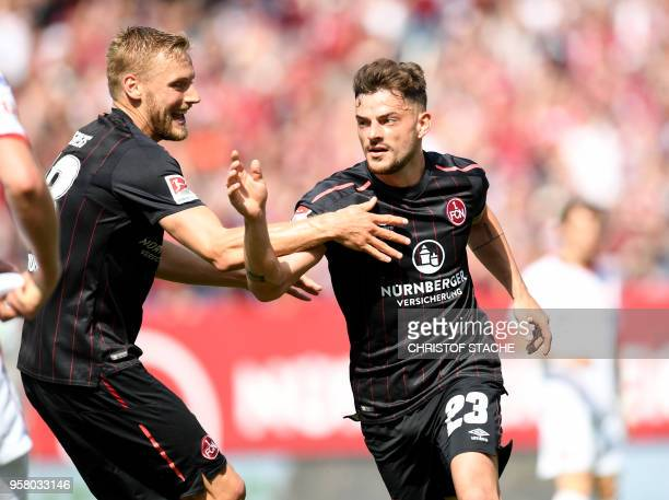 Nuremberg's midfielder Hanno Behrens and Nuremberg's midfielder Tim Leipold celebrate after their team's second goal during the German second...