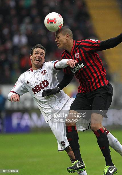 Nuremberg's midfielder Markus Feulner and Frankfurt's Brazilian defender Bamba Anderson vie for the ball during the German first division Bundesliga...