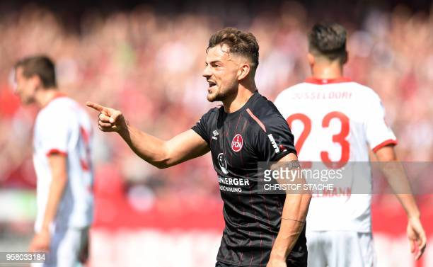 Nuremberg's midfielder Tim Leipold celebrates after his team's second goal during the German second division Bundesliga football match 1 FC Nuernberg...
