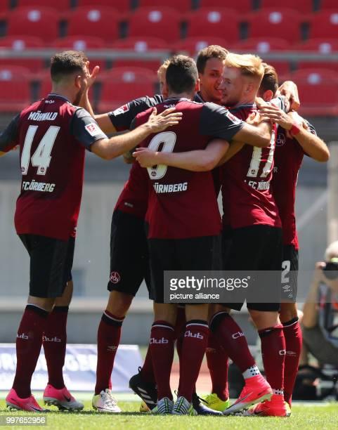 Nuremberg's Sebastian Kerk celebrates his 2:0 goal with his team during the German 2nd Bundesliga soccer match between 1. FCNuremberg and 1....