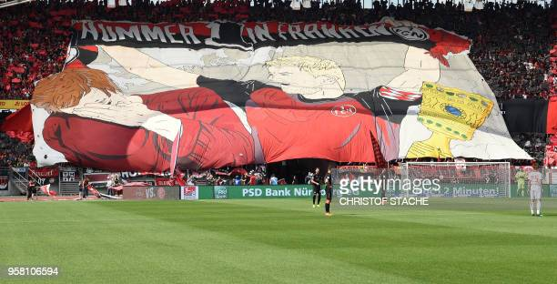 Nuremberg's supporters deploy a giant banner before the German second division Bundesliga football match 1 FC Nuremberg vs Fortuna Duesseldorf in...