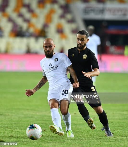 Nuri Aydin of Yeni Malatyaspor and Boakye of Olimpija Ljubljana vie for the ball during the UEFA Europa League second qualifying match between Yeni...