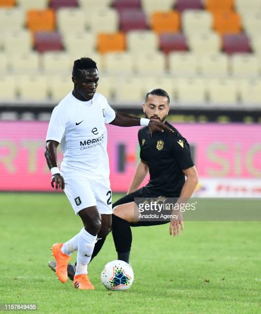 Nuri Aydin of Yeni Malatyaspor and Boayke of Olimpija Ljubljana vie for the ball during the UEFA Europa League second qualifying match between Yeni...