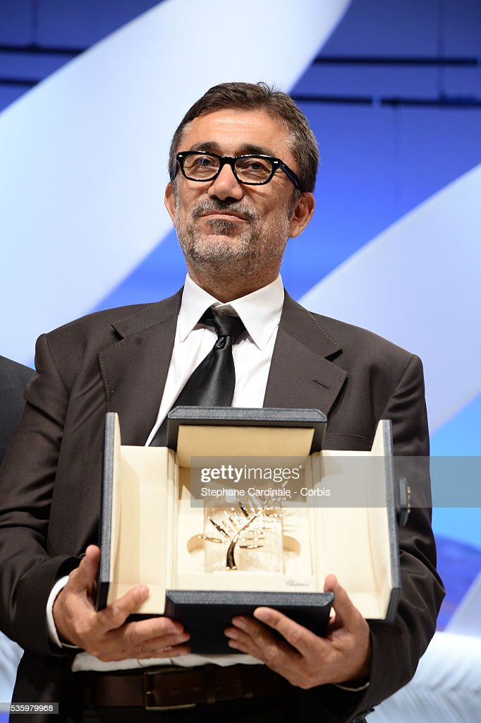 Nuri Bilge Ceylan for winning the Palme d'Or for his film 'Winter's Sleep' at the Closing Ceremony during 67th Cannes Film Festival