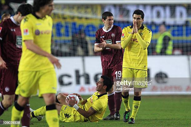 Nuri Sahin and Lucas Barrios of Dortmund react during the Bundesliga match between 1 FC Kaiserslautern and Borussia Dortmund at FritzWalterStadion on...