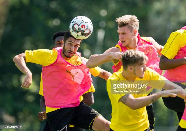 Nuri Sahin and Lukasz Piszczek of Borussia Dortmund in action during a training session as part of the training camp on August 03 2018 in Bad Ragaz...