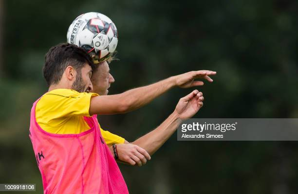 Nuri Sahin and Marco Reus head the ball during Borussia Dortmund's training camp on August 2 2018 in Bad Ragaz Switzerland