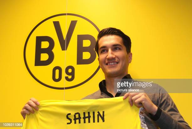 Nuri Sahin is presented as the new acquisition of Bundesliga soccer club Borussia Dortmnd and holds up his jersey at a press conference in Dortmund...