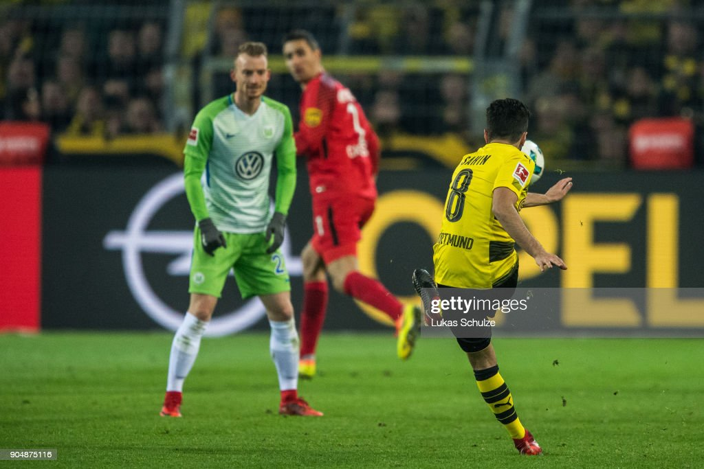 Nuri Sahin (R) kicks the ball against Goalkeeper Koen Casteels (C) of Wolfsburg during the Bundesliga match between Borussia Dortmund and VfL Wolfsburg at Signal Iduna Park on January 14, 2018 in Dortmund, Germany.