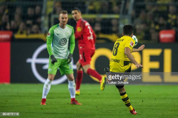 Nuri Sahin kicks the ball against Goalkeeper Koen Casteels of Wolfsburg during the Bundesliga match between Borussia Dortmund and VfL Wolfsburg at...