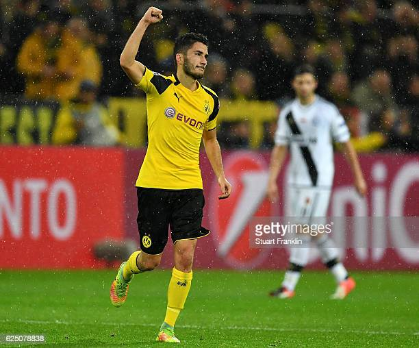 Nuri Sahin of Borussia Dortmund celebrates scoring his teams third goal during the UEFA Champions League Group F match between Borussia Dortmund and...