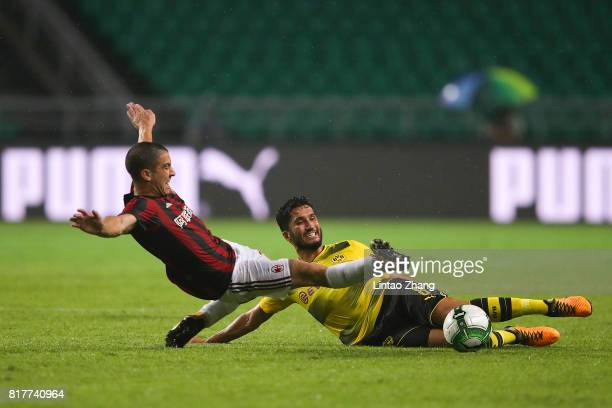 Nuri Sahin of Borussia Dortmund competes for the ball with Jose Mauri of AC Milan during the 2017 International Champions Cup football match between...