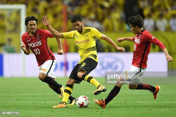 Nuri Sahin of Borussia Dortmund controls the ball during the preseason friendly match between Urawa Red Diamonds and Borussia Dortmund at Saitama...
