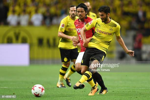 Nuri Sahin of Borussia Dortmund passes the ball during the preseason friendly match between Urawa Red Diamonds and Borussia Dortmund at Saitama...
