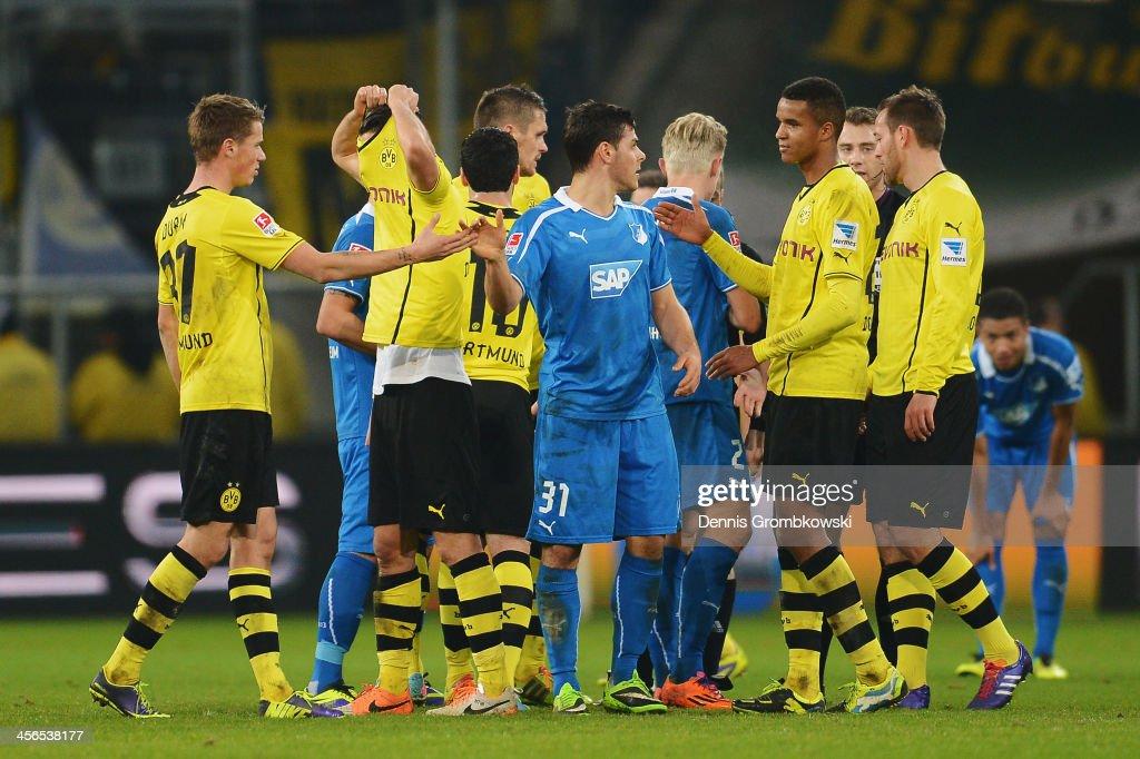 Nuri Sahin of Borussia Dortmund pulls his shirt over the head after the Bundesliga match between 1899 Hoffenheim and Borussia Dortmund at Rhein-Neckar-Arena on December 14, 2013 in Sinsheim, Germany.