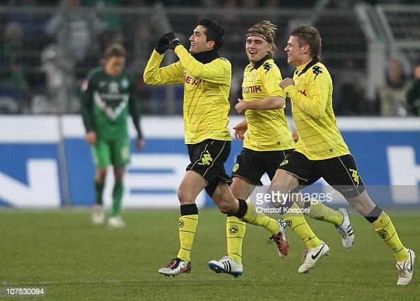 Nuri Sahin of Dormtund celebrates the first goal with team mates Marcel Schmelzer and Lukasz Piszczek during the Bundesliga match between Borussia...
