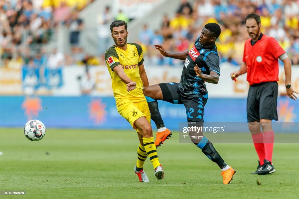 Nuri Sahin of Dortmund and Amadou Diawara of Napoli battle for the ball during the friendly match between Borussia Dortmund and S.S.C. Napoli on August 7, 2018 in St Gallen, Switzerland.