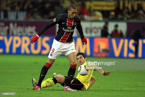 Nuri Sahin of Dortmund and Guillaume Hoarau of Paris battle for the ball during the UEFA Champions League Group J match between Borussia Dortmund and...