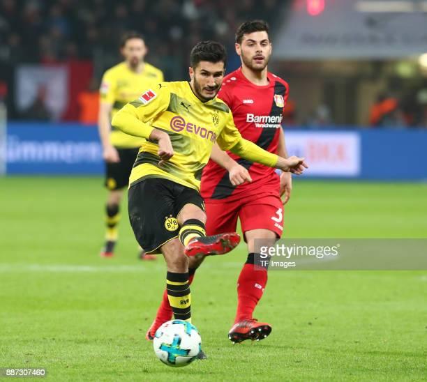 Nuri Sahin of Dortmund and Kevin Volland of Leverkusen battle for the ball during the Bundesliga match between Bayer 04 Leverkusen and Borussia...