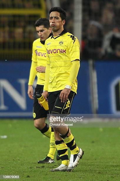 Nuri Sahin of Dortmund and Lucas Barrios of Dortmund look dejected after the 00 draw of the Bundesliga match between Borussia Dortmund and FC Schalke...