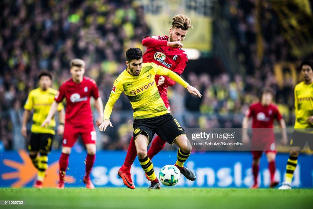 Nuri Sahin (L) of Dortmund and Lucas Hoeler (R) of Freiburg in action during the Bundesliga match between Borussia Dortmund and Sport-Club Freiburg at Signal Iduna Park on January 27, 2018 in Dortmund, Germany.