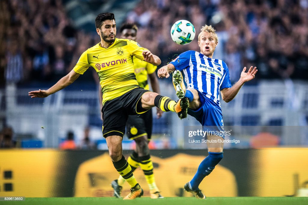 Nuri Sahin (L) of Dortmund and Per Skjelbred (R) of Berlin in action during the Bundesliga match between Borussia Dortmund and Hertha BSC at Signal Iduna Park on August 26, 2017 in Dortmund, Germany.
