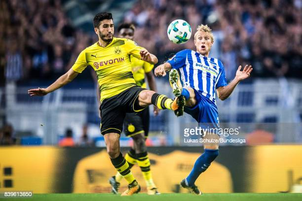 Nuri Sahin of Dortmund and Per Skjelbred of Berlin in action during the Bundesliga match between Borussia Dortmund and Hertha BSC at Signal Iduna...