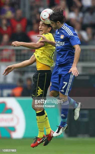 Nuri Sahin of Dortmund and Tranquillo Barnetta of Leverkusen go up for a header during the Bundesliga match between Borussia Dortmund and Bayer 04...