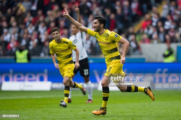 Nuri Sahin of Dortmund celebrates his team's first goal goal during the Bundesliga match between Eintracht Frankfurt and Borussia Dortmund at...