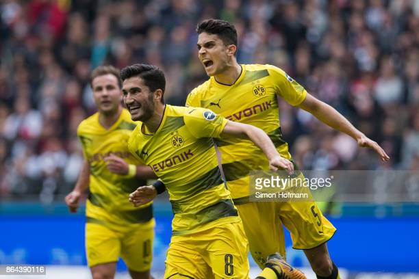 Nuri Sahin of Dortmund celebrates his team's first goal with team mate Marc Bartra during the Bundesliga match between Eintracht Frankfurt and...