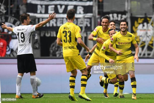 Nuri Sahin of Dortmund celebrates with his team after he scored a goal to make it 01 during the Bundesliga match between Eintracht Frankfurt and...