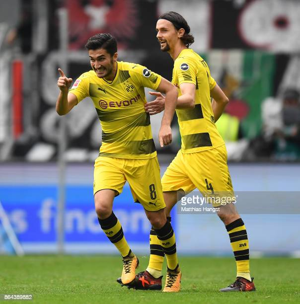 Nuri Sahin of Dortmund celebrates with Neven Subotic of Dortmund after he scored a goal to make it 01 during the Bundesliga match between Eintracht...