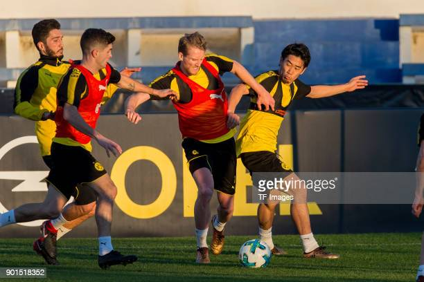 Nuri Sahin of Dortmund Christian Pulisic of Dortmund Andre Schuerrle of Dortmund and Shinji Kagawa of Dortmund battle for the ball during the...