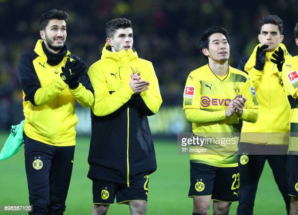 Nuri Sahin of Dortmund Christian Pulisic of Dortmund Shinji Kagawa of Dortmund and Marc Bartra Aregall of Dortmund celebrate after winning the...