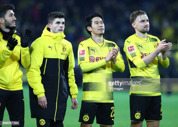 Nuri Sahin of Dortmund Christian Pulisic of Dortmund Shinji Kagawa of Dortmund and Marcel Schmelzer of Dortmund celebrate after winning the...